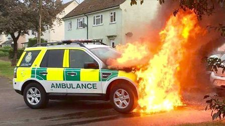 An East of England Ambulance Service vehicle caught fire while crews were attending an incident in H