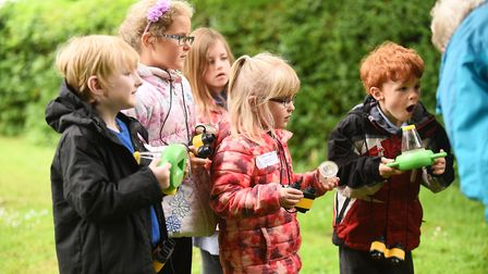 Watton Westfield Infant School Year One pupils exploring nature outside the St John The Evangelist C