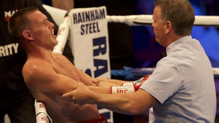 Referee Michael Alexander steps in to stop the fight in round three, despite the protests of Liam Wa