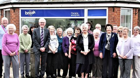 Norman Lamb with Iris Clark (foreground), with Jeff Watts (left), with staff and volunteers. Picture