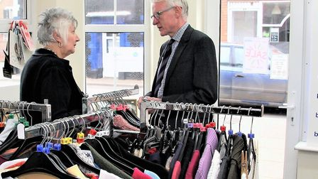 Iris Clark greets Norman Lamb to celebrate 25th anniversary of the shop's opening. Picture: Maurice