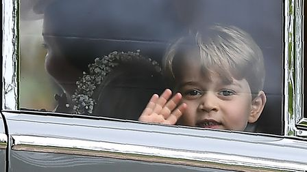 Prince George waves from a car as he leaves St Mark's church in Englefield, Berkshire, following the