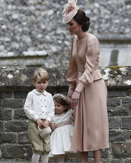 The Duchess of Cambridge with Prince George and Princess Charlotte outside St Mark's church in Engle