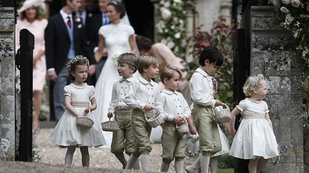 Prince George (fourth left) leaves with other page boys and flower girls following the wedding of Pi