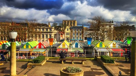 Iconic Norwich Market Place looking colourful in the spring sunshine. Picture: Laura Baxter