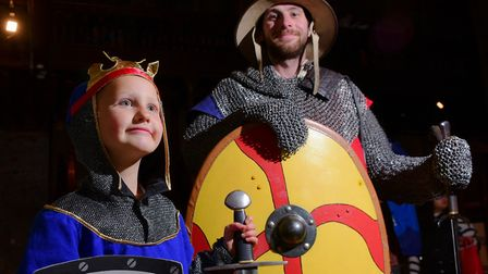 Talitha Hubbard learns about arms and armour from Lee Warden at a previous Museums at Night event at