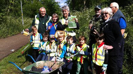 Beaver scouts and Friends of Train Wood and Marriott's Way getting the site ready for next week's Bi