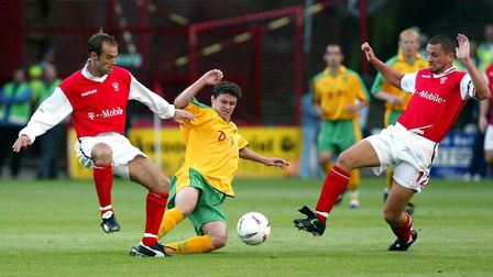 Phil Mulryne takes on the Rotherham's former Wroxham player Phil Warne, left, and Stewart Talbot. Pi