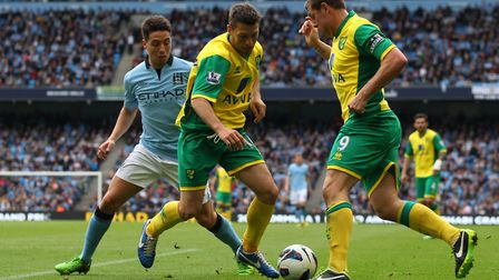 Wes Hoolahan and Grant Holt combine to take the ball off Samir Nasri at The Etihad Stadium. Picture: