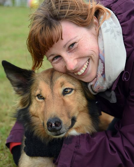 Jaine Wainwright <correct> hugs Milo after he won the best rescue dog in the dog show at the Rose Ma