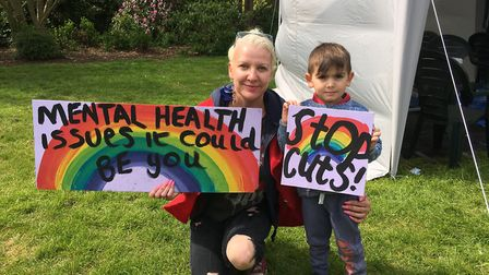 Hazel Van Der Lee with her son Vincenzo and their home-made placards. Picture: SABRINA JOHNSON