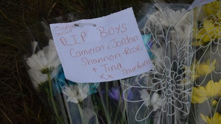 Flowers and tributes at the scene of the crash in Pulham Market, where three teenagers died. Picture
