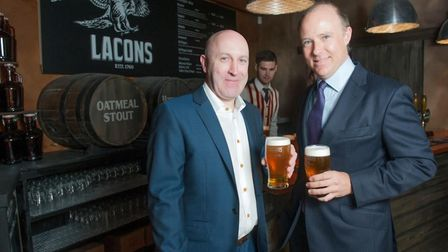 Managing director Mick Carver savouring a pint of Encore with non-executive director William Lacon.