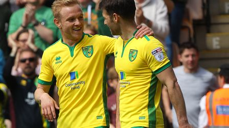 Alex Pritchard, left, congratulates Wes Hoolahan on the opening goal agains QPR. Picture: Paul Ches