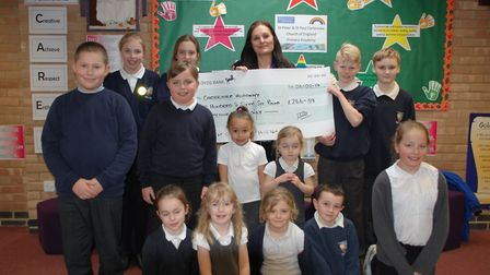 Shiona Dennison, community buying sales coordinator at Rix Petroleum, donating a cheque for pupils a