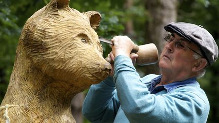 Mike Thody with his wooden sculpture of a bear called Ursula at North Norfolk District Council's (NN