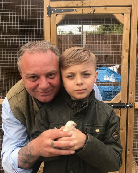Mark Overton with his son Jake and four-legged Speedy, who was hatched on their Norfolk smallholding