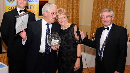 Waveney MP Lion Peter Aldous, Douglas Peck receiving the award from Mandy Holmes and Lion president