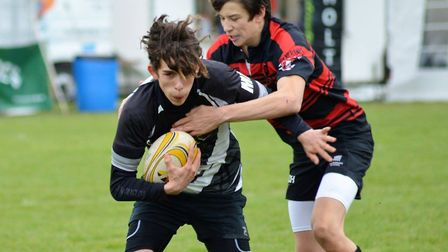 Action from Holt (black) v Wymondham in the U15 cup final at the Norfolk Big Rugby Weekend at Holt R