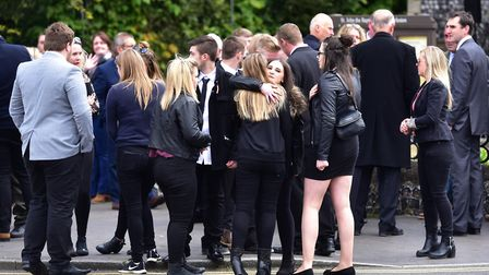 Young people comfort each other at the funeral of Kyle Warren at St John The Baptist Church, Harlest