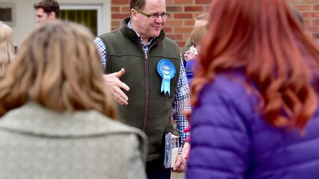 Conservative prospective parliamentary candidate George Freeman talking to parents at Yaxham primar