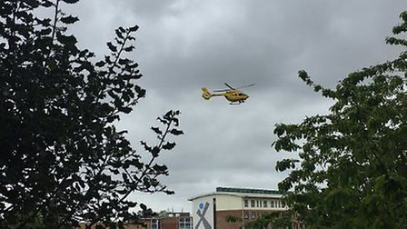 The air ambulance lands at Sprowston High School to treat a man in his 70s who was seriously injured