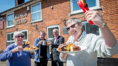 The King's Head at Lingwood has been awarded the Pub is the hub plaque for its new village cafe serv