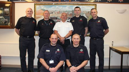 John Chelton (centre) with collegaues at Wisbech fire station on his final shift after 33 years' ser