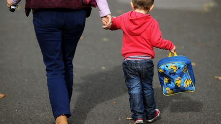 Picture of a child arriving at school. Picture: Niall Carson/PA Wire