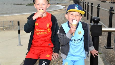 Children from Lowestoft enjoy an ice cream near the beach. Pictures: MICK HOWES