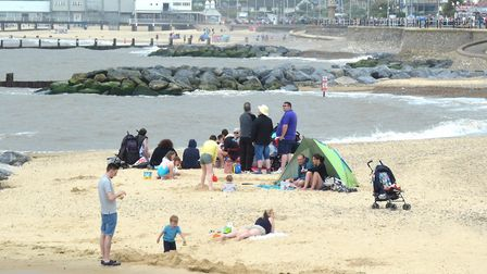 Beach-goers in Lowestoft ahead of the brief rain shower. Pictures: MICK HOWES