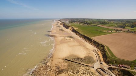 A stunning aerial photograph of the beach at West Runton, with East Runton and Cromer in the distanc