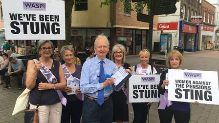 West Norfolk Conservative candidate Sir Henry Bellingham signs the Waspi pledge with members of the