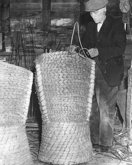 Mr Joseph Smalls an 84 year old basket maker from North Creake, at work on a straw armchair. Date un