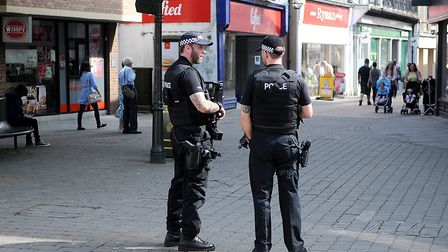 Armed police on patrol in King's lynn, as the terror threat was increased to critical. Picture: Chri
