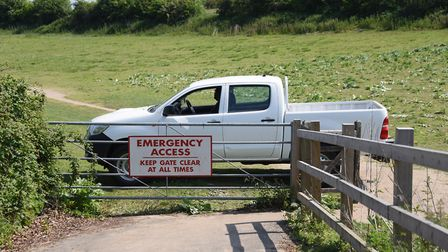 One of the vehicles parked across entrances to the UEA sports areas at Colney Lane to prevent travel
