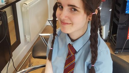 Ellie Branston-Tilley, 14, of Cromer, had 20 inches (50cms) of hair chopped off for charity. Pictur