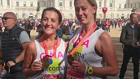 Gina Long and her friend Lisa Lumley with their London marathon medals. Why not send Gina pictures o