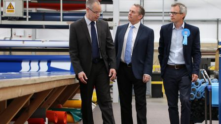 Paul Reeve, managing director of Structure-Flex, gives Liam Fox, Secretary of State for Internationa