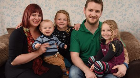 Paediatric nurse, Joe Ellis-Gage, and his family, wife, Carolyn, eight-month-old Archie; Anna, centr