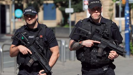 Armed police close to the Manchester Arena, the morning after a suicide bomber killed 22 people. Pic