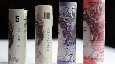 File photo of 50, 20, 10 and five pound notes as the ONS revises down its UK economy growth forecast