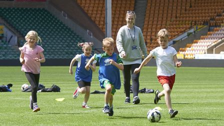 Cringleford Primary School year-two children on the pitch at Carrow Road. Picture: RICHARD LEE