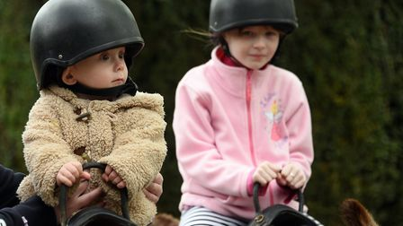 Bailey Waterson, 13-months-old, and Poppy Warminger, seven, enjoying the ride on the Parkers Donkey