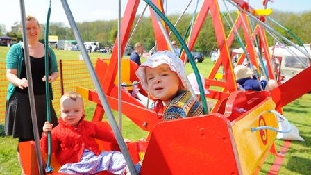 Beccles Rose May Fete at Ringsfield Village Hall. Bonny and Morris enjoying a ride on the swings.