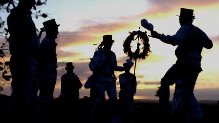 A traditional welcome to the first day of May at sunrise on the top of Knight's Hill where member