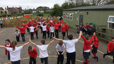 Children celebrate the opening of a new sea sanctuary by taking part in a country dance. Pictures: D