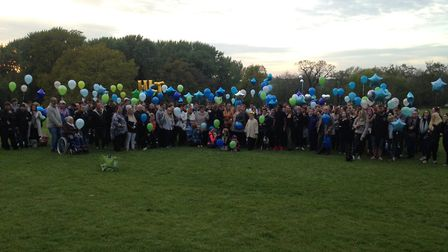 Hundreds have gathered for an emotional vigil in memory of the popular photographer Harvey Lewis Tru