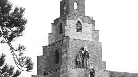 The five-storey tower of Burgh St. Peter church. Workmen were fitting medieval timbers taken from No