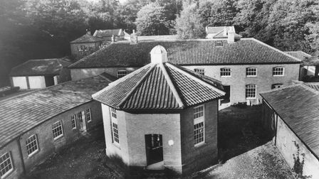 A view over the rooftops showing the unusual former brewery at Gunton Hall. Dated: 7th September 198